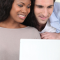 Couple watching video on laptop